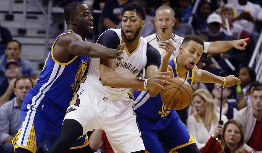 New Orleans Pelicans forward Anthony Davis (23) is fouled by Golden State Warriors guard Stephen Curry (30) right, with support from forward Draymond Green (23) during the first half of an NBA basketball game in New Orleans, La., Friday, Oct. 28, 2016. (AP Photo/Max Becherer)