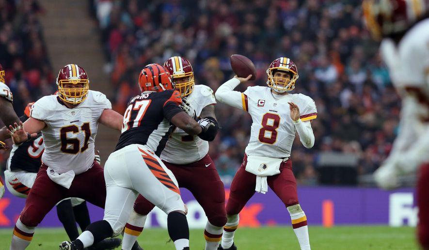 Washington Redskins quarterback Kirk Cousins (8) throws a ball during an NFL Football game between Cincinnati Bengals and Washington Redskins at Wembley Stadium in London, Sunday Oct. 30, 2016. (AP Photo/Tim Ireland)
