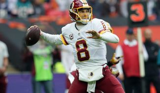 Washington Redskins quarterback Kirk Cousins (8) throws the ball during an NFL Football game between Cincinnati Bengals and Washington Redskins at Wembley Stadium in London, Sunday Oct. 30, 2016. (AP Photo/Tim Ireland)