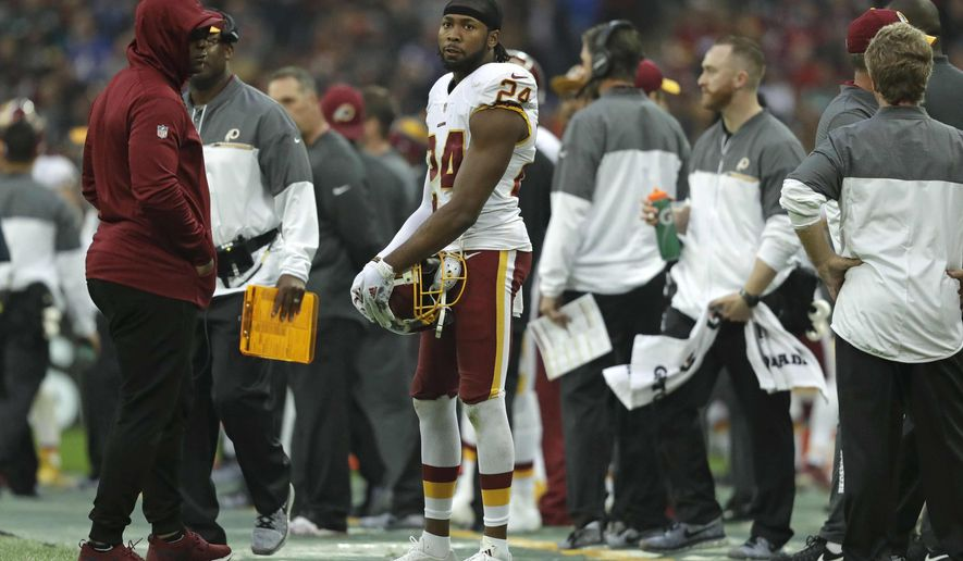 Washington Redskins cornerback Josh Norman (24) stands on the touchline during an NFL Football game against Cincinnati Bengals at Wembley Stadium in London, Sunday Oct. 30, 2016. (AP Photo/Matt Dunham)