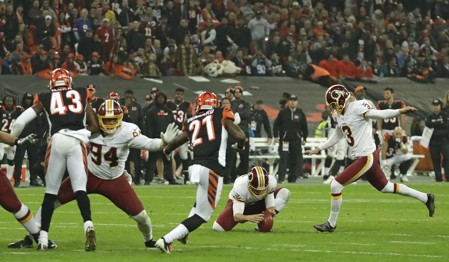 Washington Redskins kicker Dustin Hopkins (3), right, misses with a field goal attempt in over time during an NFL Football game against Cincinnati Bengals at Wembley Stadium in London, Sunday Oct. 30, 2016. (AP Photo/Matt Dunham) ** FILE **