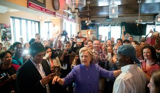 Democratic presidential candidate Hillary Clinton visits an early voting brunch at Fado Irish Pub in Miami, Sunday, Oct. 30, 2016. (AP Photo/Andrew Harnik)
