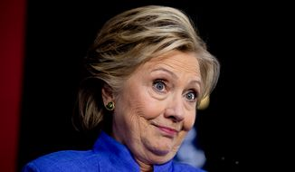 Democratic presidential candidate Hillary Clinton pauses while speaking at a rally and concert at The Manor Complex in Wilton Manors, Fla. Sunday, Oct. 30, 2016. (AP Photo/Andrew Harnik)