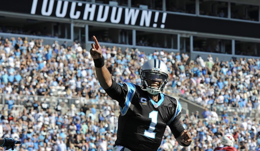 Carolina Panthers' Cam Newton (1) celebrates a Panthers touchdown against the Arizona Cardinals in the first quarter of an NFL football game in Charlotte, N.C., Sunday, Oct. 30, 2016. (AP Photo/Mike McCarn)