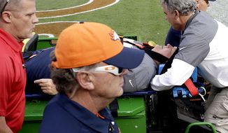 Denver Broncos offensive coordinator Wade Phillips is carted off the field after being run into by a player while on standing on the sidelines during the first half of an NFL football game against the San Diego Chargers, Sunday, Oct. 30, 2016, in Denver. (AP Photo/Jack Dempsey)