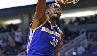 Golden State Warriors forward Kevin Durant dunks against the Phoenix Suns during the first half of an NBA basketball game Sunday, Oct. 30, 2016, in Phoenix. (AP Photo/Ross D. Franklin)