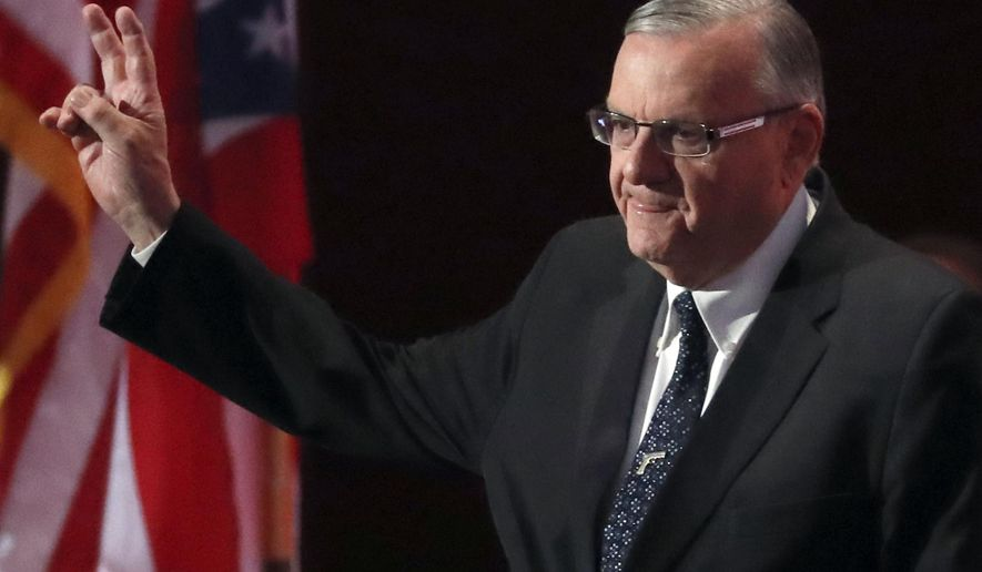FILE - In this July 21, 2016, file photo, Sheriff Joe Arpaio of Arizona walks on the stage to speak during the final day of the Republican National Convention in Cleveland. Arpaio is now the one targeted in a criminal case. He was charged two weeks before Election Day with contempt of court for defying a judge's order in a racial profiling case. (AP Photo/Paul Sancya, File)