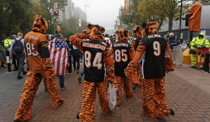 Cincinnati Bengals fans walk up Wembley Way as they arrive for an NFL Football game between Washington Redskins and Cincinnati Bengals at Wembley Stadium in London, Sunday Oct. 30, 2016. (AP Photo/Matt Dunham)