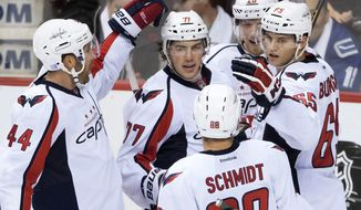 Washington Capitals' Brooks Orpik, T.J. Oshie, Nate Schmidt, Lars Eller and Andre Burakovsky, from left, celebrate Oshie's goal against the Vancouver Canucks during the third period of an NHL hockey game Saturday, Oct. 29, 2016, in Vancouver, British Columbia. (Darryl Dyck/The Canadian Press via AP)