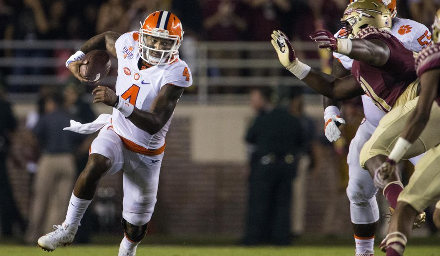 Clemson quarterback Deshaun Watson scrambles during the first half of the team's NCAA college football game against Florida State in Tallahassee, Fla., Saturday, Oct. 29, 2016. (AP Photo/Mark Wallheiser)