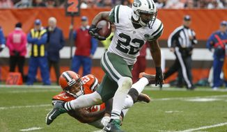 New York Jets running back Matt Forte (22) breaks away from Cleveland Browns cornerback Joe Haden (23) on the run in the second half of an NFL football game, Sunday, Oct. 30, 2016, in Cleveland. (AP Photo/Ron Schwane)