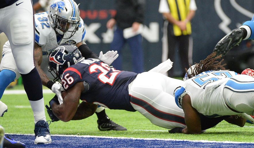 Houston Texans running back Lamar Miller (26) scores against the Detroit Lions on a 1-yard run during the first half of an NFL football game Sunday, October, 30, 2016, in Houston. (AP Photo/George Bridges)