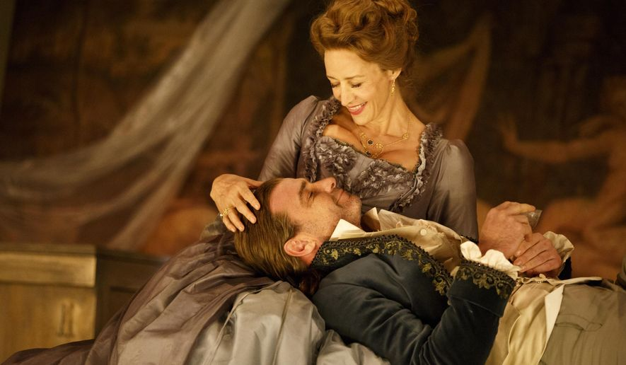 """In this image released by Boneau/Bryan-Brown, Janet McTeer appears as the Marquise de Merteuil and Liev Schreiber appears as Le Vicomte de Valmont during a performance of the Broadway revival of """"Les Liaisons Dangereuses,"""" opening Sunday in New York. (Joan Marcus/Boneau/Bryan-Brown, via AP)"""