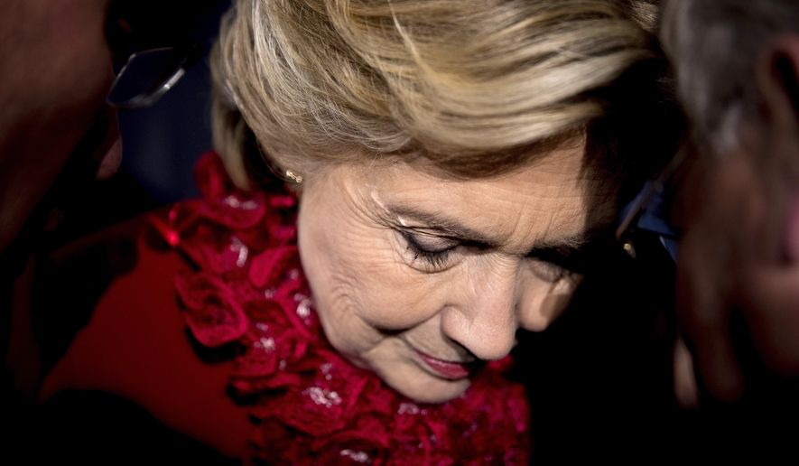 Democratic presidential candidate Hillary Clinton listens to a members of the audience after speaking at a rally at Smale Riverfront Park in Cincinnati, Monday, Oct. 31, 2016. (AP Photo/Andrew Harnik)