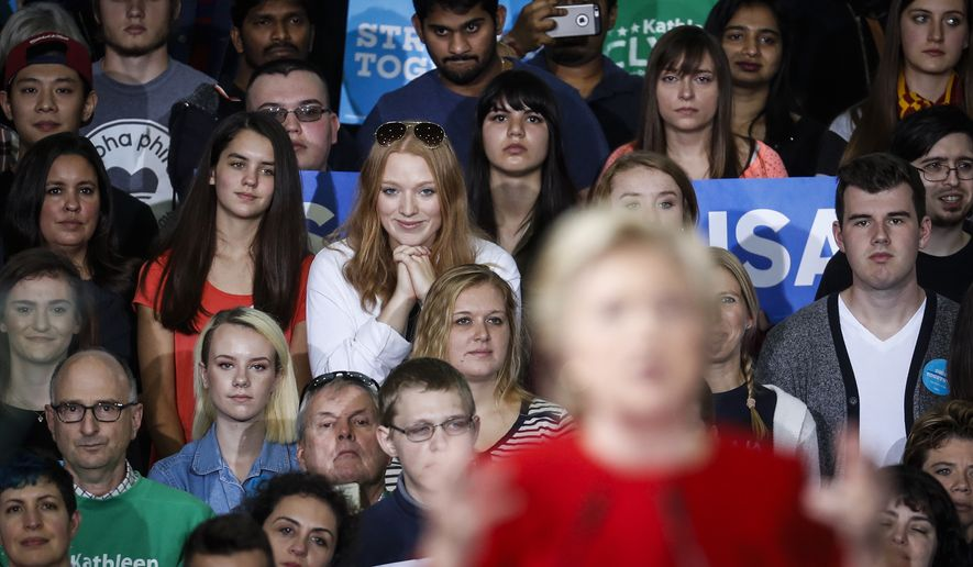 Attendees listen as Democratic presidential candidate Hillary Clinton speaks at a campaign rally at Kent State University, Monday, Oct. 31, 2016, in Kent, Ohio. (AP Photo/John Minchillo)