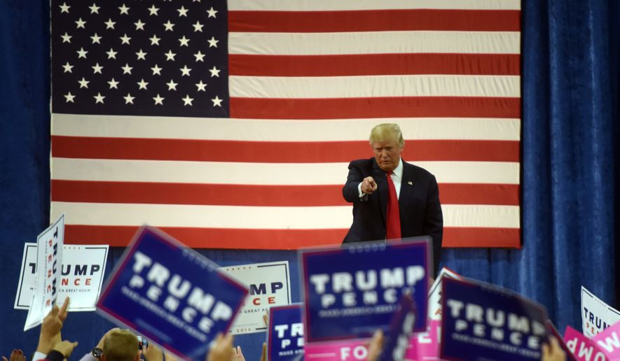 Donald Trump points the crowd as he walks off the stage at the end of his campaign at the University of Northern Colorado campus in Greeley, Colo., Sunday, Oct. 30, 2016. (Joshua Polson/The Greeley Tribune via AP)