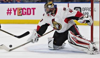 Ottawa Senators' Craig Anderson (41) makes a save during second period NHL hockey action against the Edmonton Oilers, in Edmonton, Sunday, Oct. 30, 2016. Anderson's 35th career shutout was extra special for him and his teammates. Anderson returned following his wife's cancer diagnosis and made 37 saves for his second shutout in two starts, helping the Senators beat the Oilers 2-0. (Jason Franson/The Canadian press via AP)