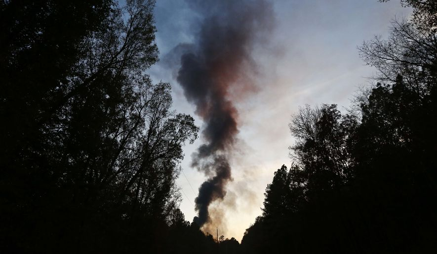 A plume of smoke rises from the site of an explosion on the Colonial Pipeline on Monday, Oct. 31, 2016, in Helena, Ala. Colonial Pipeline said in a statement that it has shut down its main pipeline in Alabama after the explosion in a rural part of the state outside Birmingham. (AP Photo/Brynn Anderson)