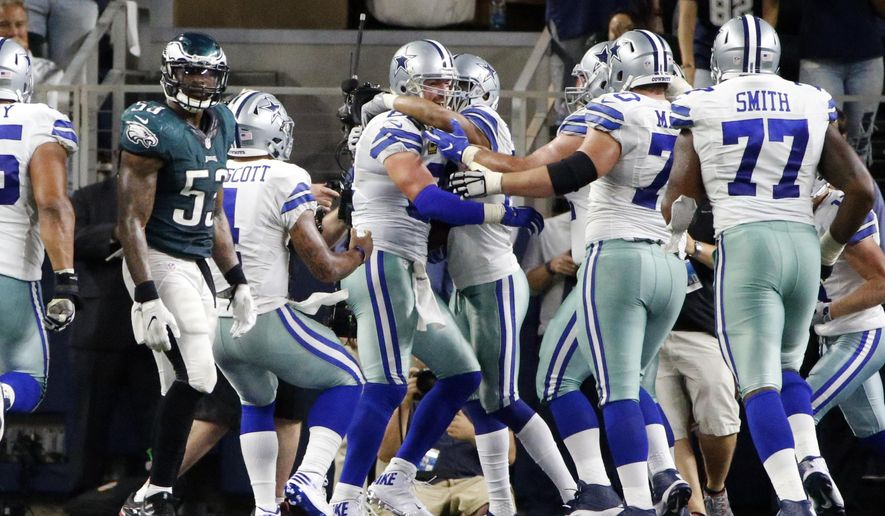 Philadelphia Eagles outside linebacker Nigel Bradham (53) walks away as the Dallas Cowboys celebrate with tight end Jason Witten, center left, after Witten caught a pass in overtime in an NFL football game, Sunday, Oct. 30, 2016, in Arlington, Texas. The Cowboys won 29-23. (AP Photo/Ron Jenkins)