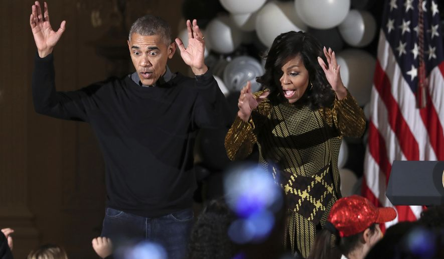 "President Barack Obama and the first lady Michelle Obama dance to the beat of Michael Jackson's ""Thriller"" at they welcome children from Washington area and children of military families to trick-or-treat celebrating Halloween at the South Portico of the White House in Washington, Monday, Oct. 31, 2016. (AP Photo/Manuel Balce Ceneta)"