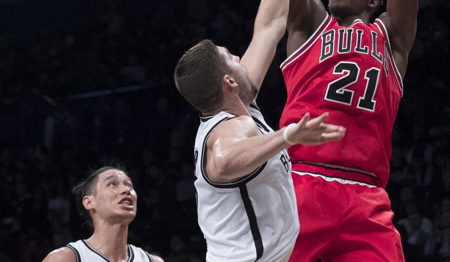 Chicago Bulls guard Jimmy Butler (21) goes to the basket against Brooklyn Nets guard Joe Harris and guard Jeremy Lin (7) during the first half of an NBA basketball game, Monday, Oct. 31, 2016, in New York. (AP Photo/Mary Altaffer)