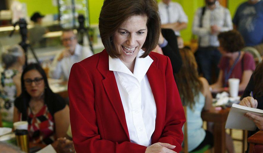 FILE - In this May 31, 2016, file photo, Nevada Democratic Senate candidate Catherine Cortez Masto meets with people at a campaign event at a restaurant in Las Vegas. Masto could be the first Latina while women could have a record number in the Senate, though nowhere near the number of the population at large.  (AP Photo/John Locher, File)