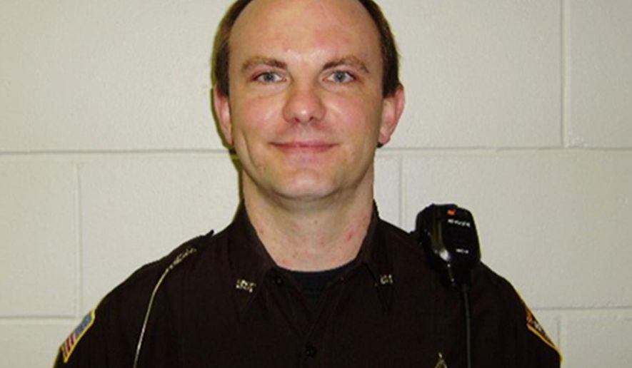 This undated photo provided by the Rusk County Sheriff's Office in Ladysmith, Wis., shows Deputy Dan Glaze, who was killed Saturday night, Oct. 29, 2016, as he investigated a report of a suspicious vehicle in a field several miles from the suspect's residence near Ladysmith. Court records show the man arrested Sunday in the fatal shooting has an extensive criminal record. (Rusk County Sheriff's Office via AP)