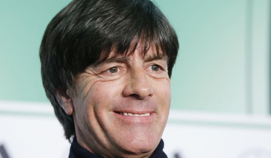 Coach of German national soccer team Joachim Loew smiles after signing a new contract in Frankfurt, Germany, Monday, Oct. 31, 2016.(AP Photo/Michael Probst)