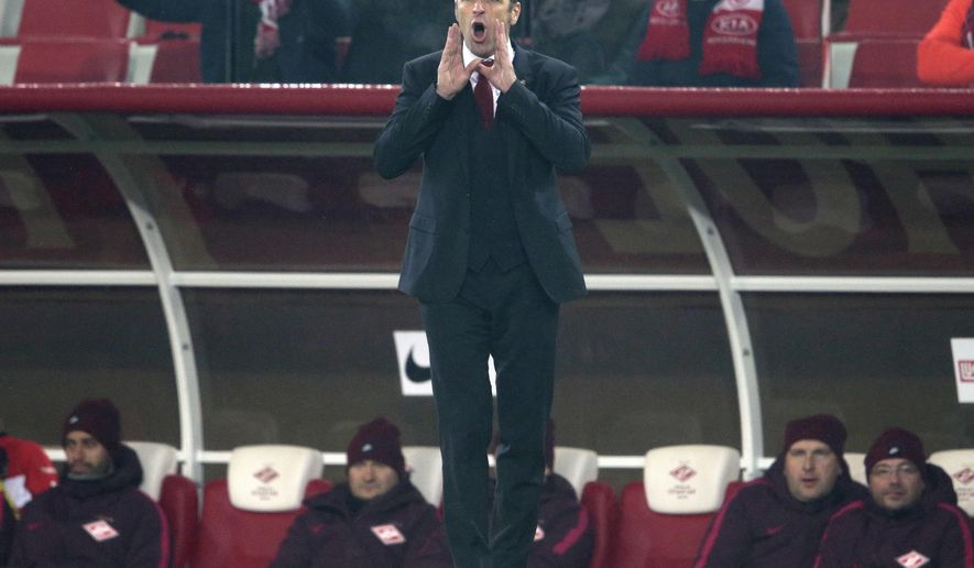 In this photo made on Saturday, Oct. 29, 2016 Spartak's head coach Massimo Carrera, of Italy, urges his team on during to the national championship soccer match between Spartak Moscow and CSKA in Moscow, Russia. Since being promoted to Spartak head coach, Carrera's fortunes are on the rise as he's turned Spartak into the Russian league leader in the process beating arch-rival CSKA 3-1. In contrast the fortunes of CSKA's Leonid Slutsky continue to plummet and now he's under pressure at CSKA. (AP Photo/Ivan Sekretarev)