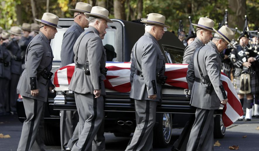 The casket of New York State Police Trooper Timothy Pratt is carried to St. Michael's Church on Monday, Oct. 31, 2016, in South Glens Falls, N.Y. Pratt died after being struck by a car while assisting a trucker who had stopped in a highway median in front of the trooper station in Wilton, where he worked. (AP Photo/Mike Groll)