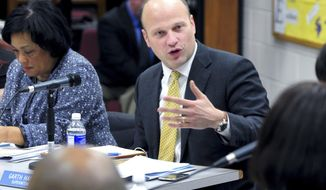 FILE - In this Feb. 10, 2014 file photo, New Haven Superintendent of Schools Garth Harries, center, speaks at a Board of Education meeting at Hill Regional Career High School, in New Haven, Conn. After only slightly more than three years, and repeated clashes with members of the city's school board, Harries is stepping down Monday, Oct. 31, 2016. He lasted about as long as the average for superintendents in urban American districts, a turnover rate that has been on the rise in recent years. (Arnold Gold/New Haven Register via AP, File)
