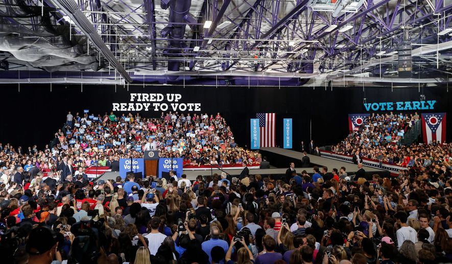 """President Obama stumps Tuesday for Democratic presidential candidate Hillary Clinton at Capital University in Columbus, Ohio. He told the crowd not to be """"bamboozled"""" by Mrs. Clinton's Republican rival in the race, Donald Trump, whom he called a con artist. (Associated Press)"""