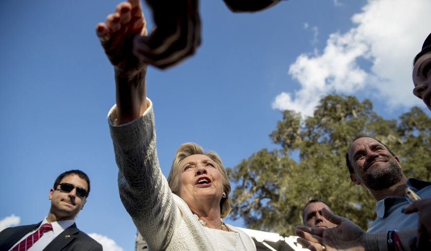 Democratic presidential candidate Hillary Clinton greets members of the audience after speaking at a rally at Pasco-Hernando State College in Dade City, Fla., Tuesday, Nov. 1, 2016. (AP Photo/Andrew Harnik)