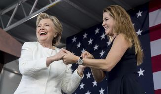 Democratic presidential candidate Hillary Clinton takes the stage with Alicia Machado, who won the Miss Universe pageant in 1996, to speak at a rally at Pasco-Hernando State College in Dade City, Fla., Tuesday, Nov. 1, 2016. (AP Photo/Andrew Harnik)