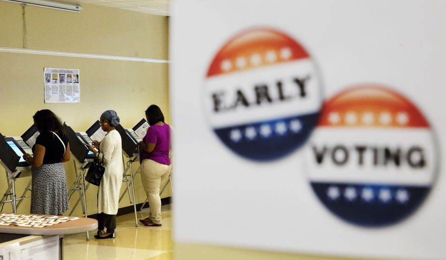 Voters cast ballots during early voting ahead of next week's general election in Atlanta, Tuesday, Nov. 1, 2016. Early voting, via mail or in-person, is underway in 37 states. In all, more than 46 million people, or as much as 40 percent of the electorate, are expected to vote before Election Day, Nov. 8. (AP Photo/David Goldman)