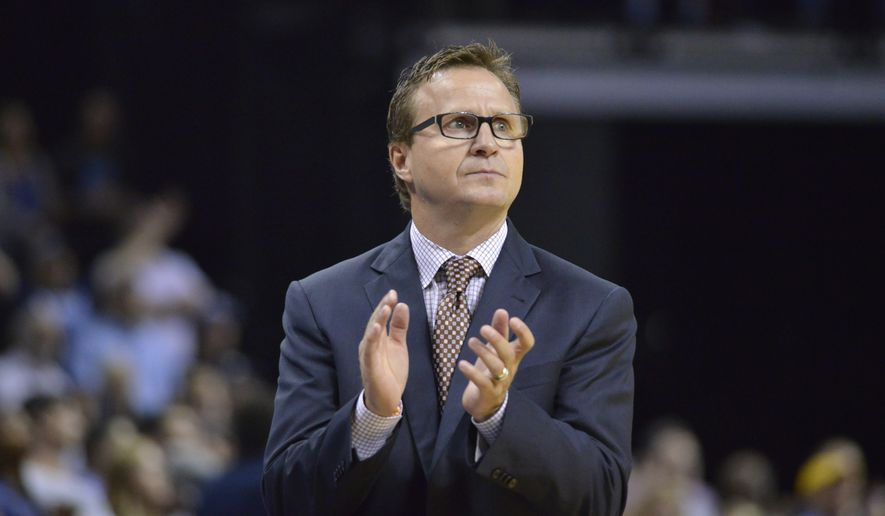Washington Wizards head coach Scott Brooks reacts in the second half of an NBA basketball game Sunday, Oct. 30, 2016, in Memphis, Tenn. (AP Photo/Brandon Dill)