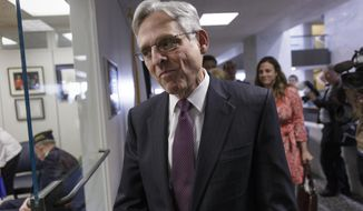 FILE - In this April 14, 2016 file photo, Judge Merrick Garland, President Barack Obama's choice to replace the late Justice Antonin Scalia on the Supreme Court, arrives for a meeting on Capitol Hill in Washington. The Supreme Court has existed with its full complement of nine justices for close to 150 years, no matter who occupied the White House. Now some Republicans are suggesting that only a president from their political party can fill vacancies.  (AP Photo/J. Scott Applewhite, File)