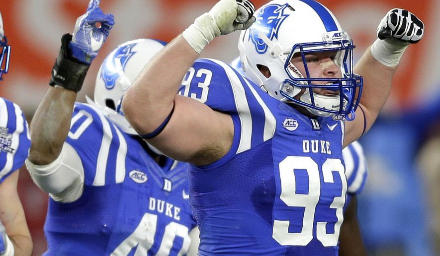 FILE - In this Dec. 26, 2015, file photo, Duke's A.J. Wolf, right, reacts after a stop during the first half of the Pinstripe Bowl NCAA college football game against Indiana at Yankee Stadium in New York. Duke isn't just losing games these days. It's also losing captains. The Blue Devils picked four captains before the season and three of them are out for the season with injuries. That leaves defensive lineman A.J. Wolf as the last of those leaders who will play this week against No. 23 Virginia Tech. (AP Photo/Seth Wenig, File0