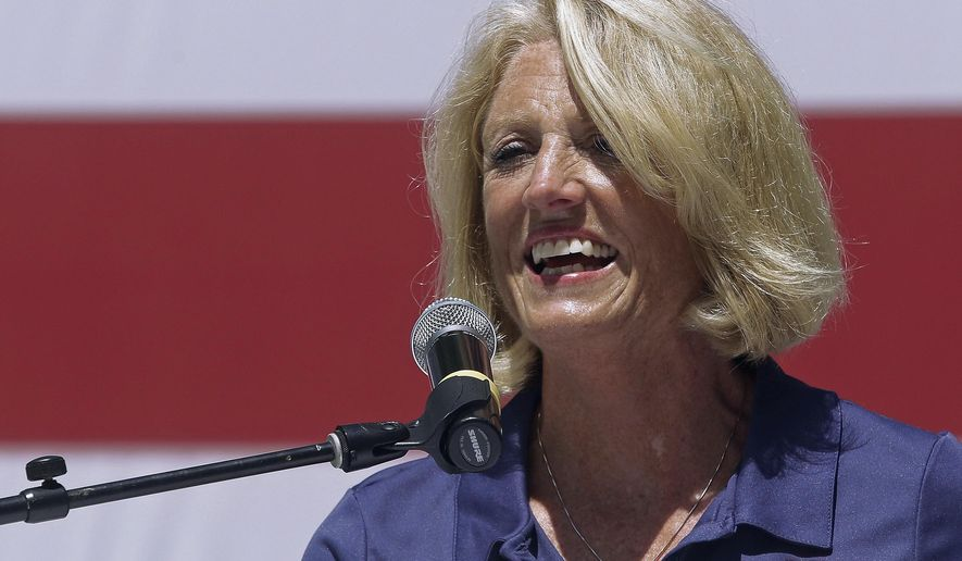 FILE - In this Aug. 17, 2016, file photo, Illinois state Comptroller Leslie Munger speaks to supporters at a rally in Springfield, Ill. Munger faces Democrat Susana Mendoza, Libertarian Claire Ball, and the Green Party's Tim Curtin in the general election. (AP Photo/Seth Perlman, File)