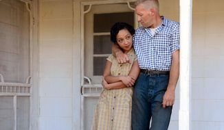 "This image released by Focus Features shows Ruth Negga, left, and Joel Edgerton in a scene from, ""Loving."" (Ben Rothstein/Focus Features via AP)"