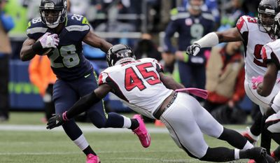 FILE - In this Oct. 16, 2016, file phot, Seattle Seahawks running back C.J. Spiller (28) is tackled by Atlanta Falcons strong middle linebacker Deion Jones (45) during the first half of an NFL football game against the Atlanta Falcons in Seattle. The New York Jets will sign Spiller and waive newly acquired Knile Davis, a person with direct knowledge of the team's plans told The Associated Press, Tuesday, Nov. 1, 2016. Davis was claimed off waivers from the Green Bay Packers on Tuesday, but will be waived when the Jets sign Spiller on Wednesday, according to the person who spoke to the AP on condition of anonymity because the team had not announced its plans. (AP Photo/Elaine Thompson, File)