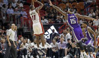 Miami Heat guard Dion Waiters (11) shoots as Sacramento Kings center DeMarcus Cousins (15) defends during the first half of an NBA basketball game, Tuesday, Nov. 1, 2016, in Miami. (AP Photo/Alan Diaz)