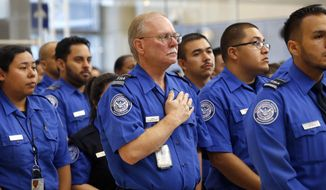 Transportation Security Administration personnel take part in a formal ceremony of remembrance on the third anniversary of a shooting rampage that killed a TSA officer and wounded others at Los Angeles International Airport Tuesday, Nov. 1, 2016. Officers, travelers and others at the airport observed a moment of silence at 9:20 a.m. to honor TSA agent Officer Gerardo Hernandez, who was killed on Nov. 1, 2013. Paul Ciancia, 26, has pleaded guilty to murder and 10 other charges, and is scheduled to be sentenced to life in prison on Monday, Nov. 7. (AP Photo/Nick Ut)