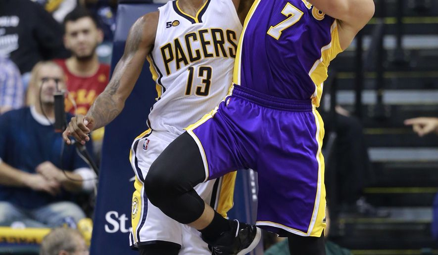Indiana Pacers forward Paul George (7) blocks a shot attempt by Los Angeles Lakers forward Larry Nance Jr. during the second half of an NBA basketball game, Tuesday, Nov. 1, 2016, in Indianapolis. Indiana won 115-108. (AP Photo/R Brent Smith)