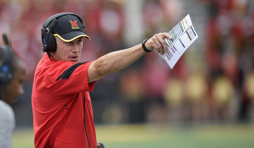 FILE - In this Sept. 3, 2016, file photo, Maryland head coach DJ Durkin gestures during the second half of an NCAA football game against Howard in College Park, Md. Maryland first-year coach Durkin must improve his own defense if the Terrapins are to have a chance to upset the second-ranked Wolverines on Nov. 5. (AP Photo/Nick Wass, File)