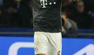 Bayern's Robert Lewandowski, celebrates after scoring during the Group D Champions League soccer match between PSV Eindhoven and Bayern Munich at the Philips stadium in Eindhoven, Netherlands, Tuesday, Nov. 1, 2016. (AP Photo/Peter Dejong)