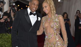 """File - In this May 4, 2015, file photo, Jay Z, left, and Beyonce arrive at The Metropolitan Museum of Art's Costume Institute benefit gala celebrating """"China: Through the Looking Glass"""" in New York. The couple dressed as Barbie and Ken for Halloween in photos posted on Instagram Nov. 1, 2016. (Photo by Evan Agostini/Invision/AP, File)"""