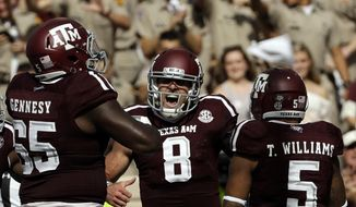FILE - In this Oct. 8, 2016, file photo, Texas A&M quarterback Trevor Knight (8) celebrates with teammates after rushing for a touchdown against the Tennessee during the first half of an NCAA college football game in College Station, Texas. Texas A&M was ranked fourth behind Alabama, Clemson and Michigan in the season's first College Football Playoff rankings, announced Tuesday, Nov. 1, 2016. (AP Photo/David J. Phillip, File)