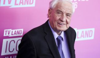 """FILE - In this April 10, 2016 file photo, Garry Marshall arrives at the 2016 TV Land Icon Awards at Barker Hangar in Santa Monica, Calif. The Hollywood reporter says CBS' """"The Odd Couple"""" will pay a star-studded tribute to Marshall on its Nov. 7, 2016, episode. (Photo by Rich Fury/Invision/AP, File)"""