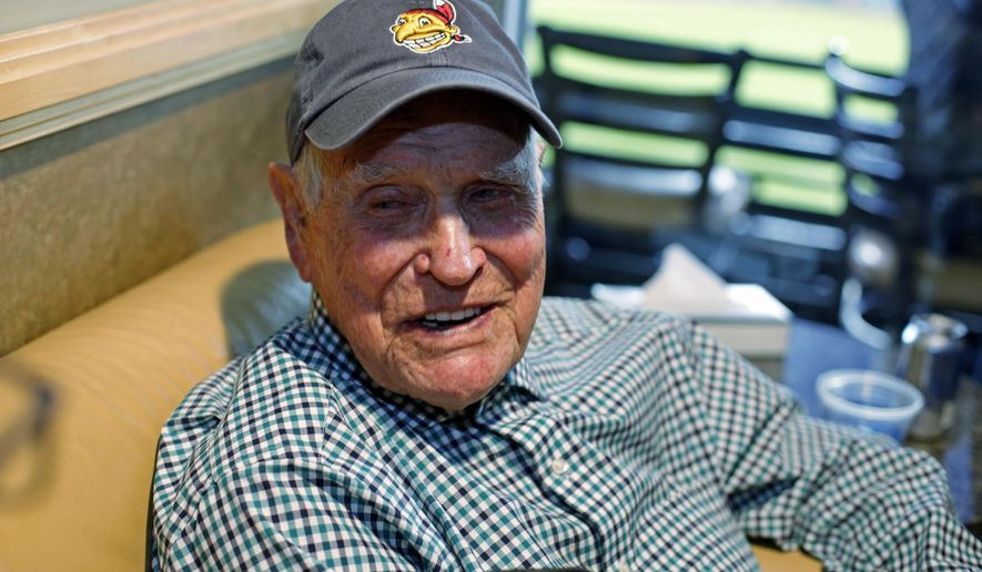 The last living player from the 1948 Cleveland Indians, Eddie Robinson sits in a box at Wrigley Field before Game 6 of the Major League Baseball World Series against the Chicago Cubs Tuesday, Nov. 1, 2016, in Cleveland. (AP Photo/Gene J. Puskar)